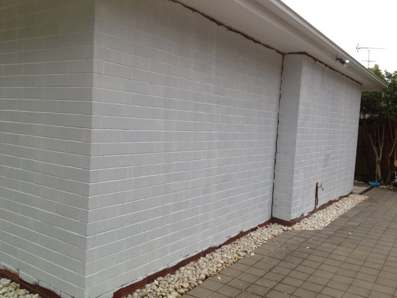 How To Bag A Painted Brick Wall